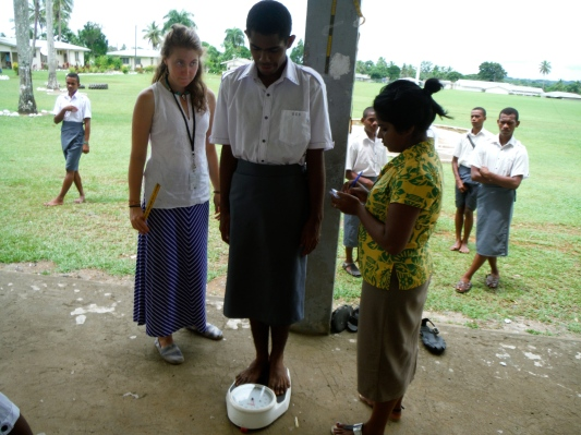 Conducting a health screening at a local secondary school
