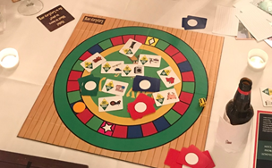 """Capitalism is So Much Easier!"" Learning Savings through Playing a Board Game"